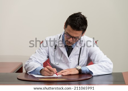 Doctor Writing A Letter - Notes Or Signing A Document Or Agreement - stock photo