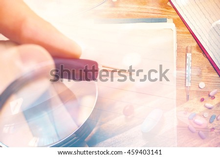 Doctor writing drugs prescription for the patient's therapy, close up with selective focus - stock photo