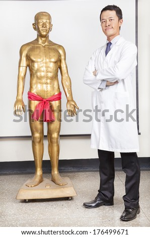 doctor writing on a medical chart with patient. Fake patient  - stock photo