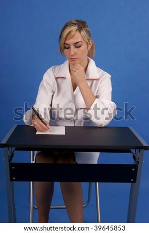 Doctor writing prescription - stock photo