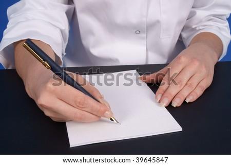 Doctor writing prescription. Close up - stock photo