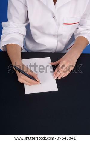 Doctor writing prescription. Closeup. - stock photo