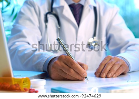 Doctor writing prescription selective focus
