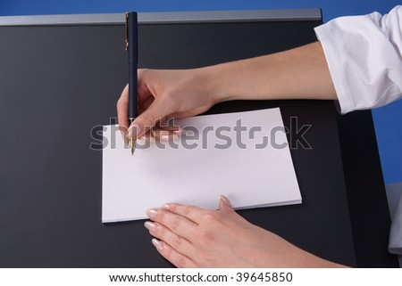 Doctor writing prescription. Side view. - stock photo