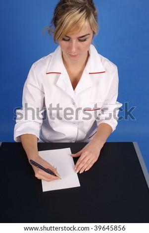 Doctor writing prescription. Top view - stock photo