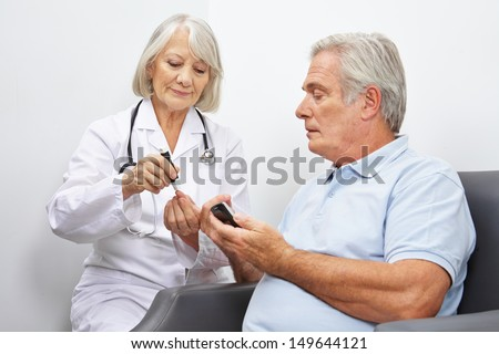 Doctore making blood sugar test for senior man in her office
