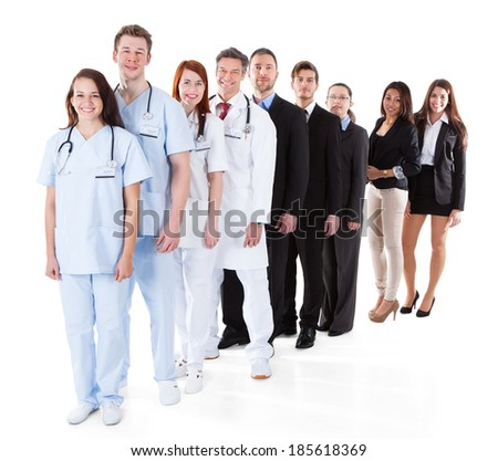 Doctors and managers standing in row. Isolated on white - stock photo