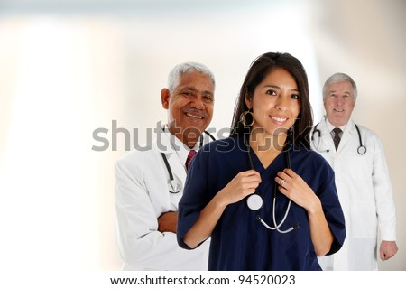 Doctors and nurse standing in a hospital - stock photo