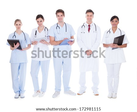 Doctors And Nurses In A Group Standing Over White Background - stock photo