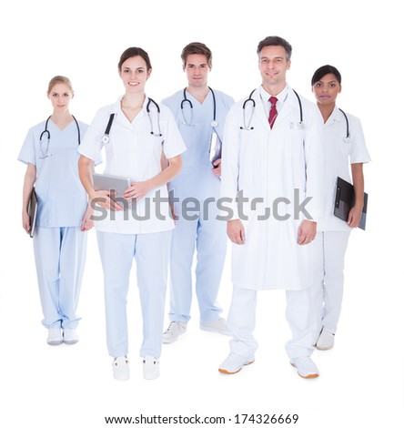 Doctors And Nurses In A Group Standing Over White Background