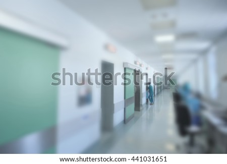 Doctors and nurses walking in hospital hallway, blurred motion. - stock photo