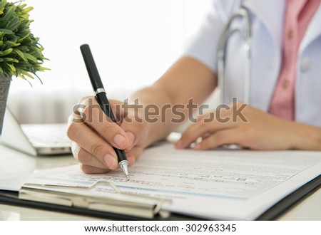 Doctors are recorded patient data for analysis. working concept. - stock photo