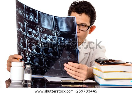 Doctors are viewing film X-ray of the patient,Concept medicine - stock photo