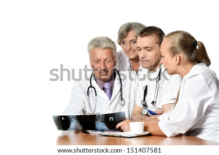 doctors at the table on white background - stock photo