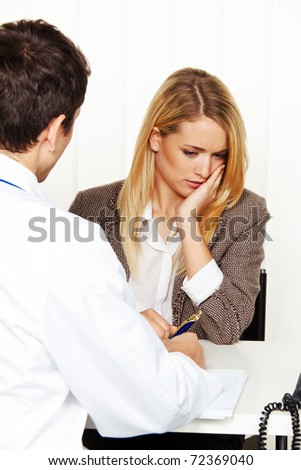 Doctors call. Patient and doctor talking to a doctor's office - stock photo