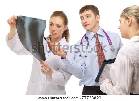 Doctors examining an X-ray picture, closeup - stock photo