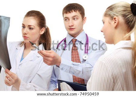 Doctors examining  X-ray closeup - stock photo