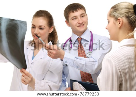 Doctors examining  X-ray, closeup - stock photo