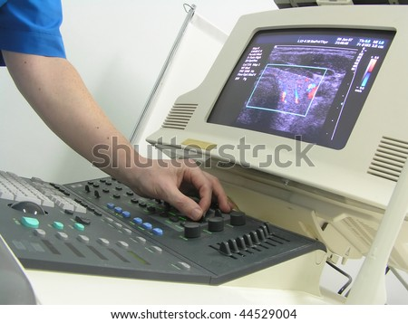 doctors hand and ultrasound machine - stock photo