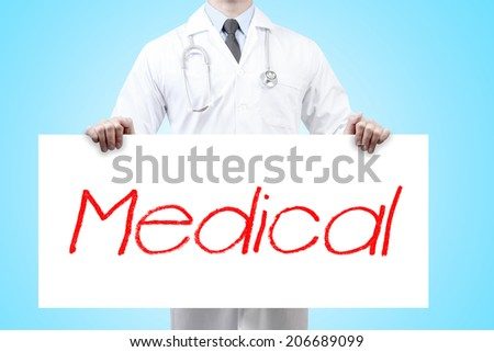 doctors holding a white banner have word medical  - stock photo