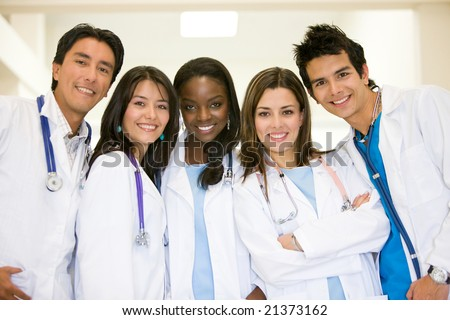 doctors in a hospital smiling and looking friendly - stock photo