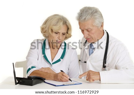 doctors in a white coat with a stethoscope - stock photo