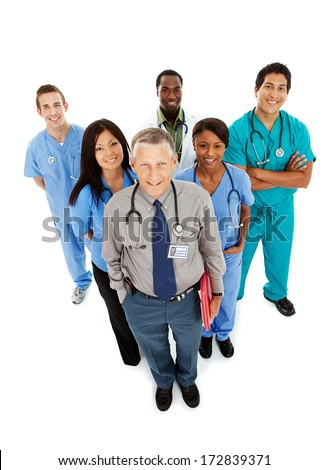 Doctors: Mature Doctor Leads Team of Health Professionals - stock photo