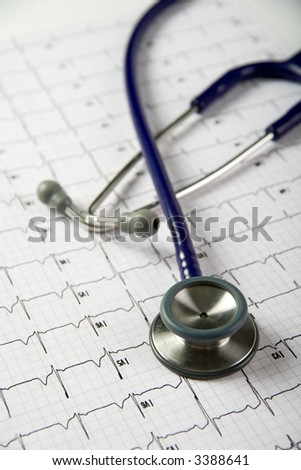 Doctors stethoscope on top of a patients ekg, reviewing records or progress - stock photo