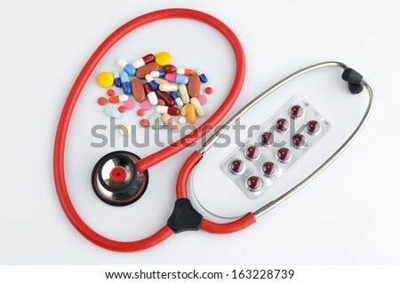 Doctors Stethoscope pills and tablets treatment - stock photo
