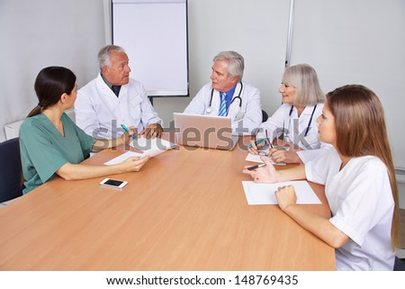 Doctors talking in a team training seminar - stock photo