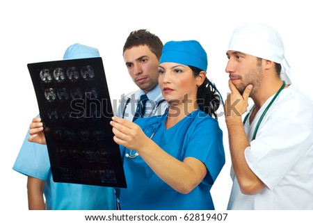 Doctors team looking worried and seriously at magnetic resonance imaging and having conversation - stock photo