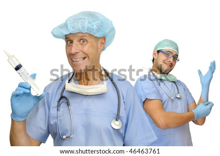 Doctors with crazy faces, big syringe and gloves isolated in white - stock photo