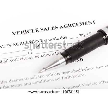 Document and Form of a Vehicle Sales Agreement - stock photo