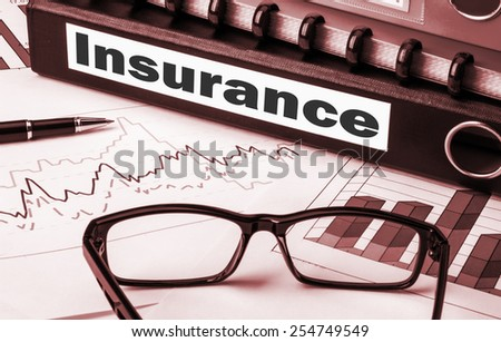 document folder with label insurance - stock photo