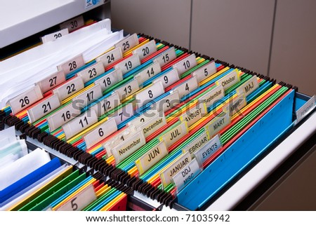 Document folders sorted for archive with colors and numbers - stock photo