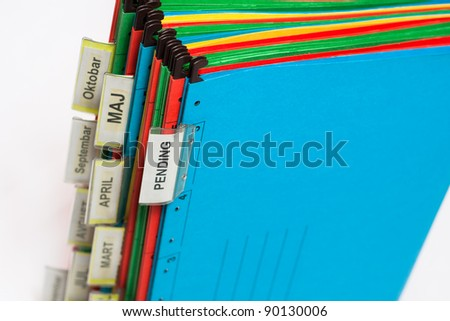 Document folders sorted for archiving with colors and labels - stock photo