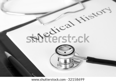 "Document showing ""medical history"", stethoscope and a pen - stock photo"