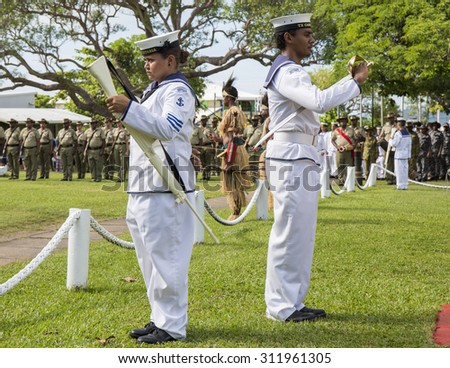 Documentary Editorial Image - Thursday Island, Torres Strait Queensland Australia.ANZAC  day 2015 on Thursday Island in the Torres Strait with navy personal raising the flag. - stock photo