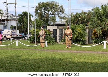 Documentary Editorial Image :Thursday Island, Torres Strait Queensland Australia â?? April 2015:Torres Strait islanders in traditional war dress participating in ANZAC day remembrance ceremony on TI. - stock photo