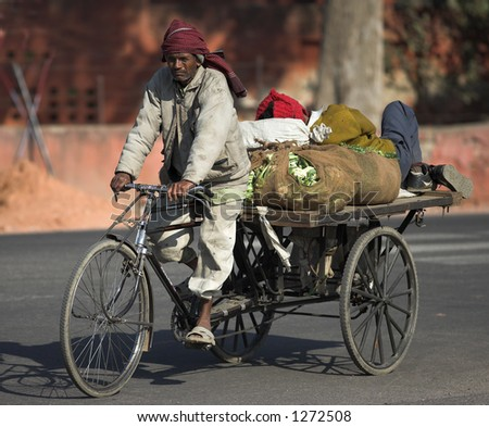 "Documentary: People of India; a typical ""bike-truck"" seen in the streets of New Delhi - stock photo"