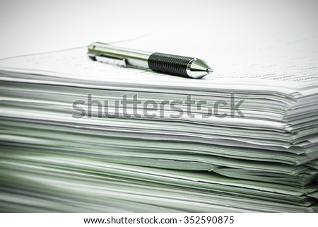 Documents and ball pen on a table