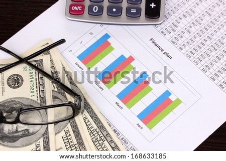 Documents, money and glasses close-up - stock photo