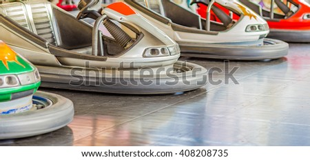 dodgems, small electric cars in a small town fair - stock photo