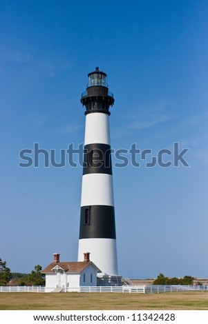 Dodie Island Lighthouse in a clear blue sky.