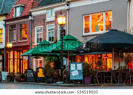DOESBURG, THE NETHERLANDS - NOVEMBER 19, 2016: Ancient houses with bars and restaurants during sunset in Doesburg, The Netherlands