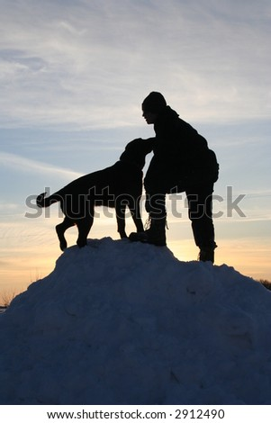 dog and boy in sunset - stock photo