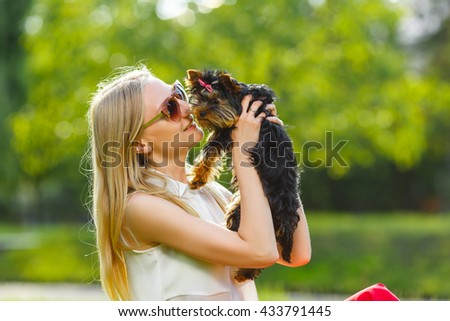 Dog and his owner - Cool dog and young women having fun in a park - Concepts of friendship,pets,togetherness - stock photo