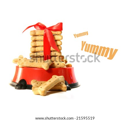 Dog biscuits  in bowl with red bow - stock photo