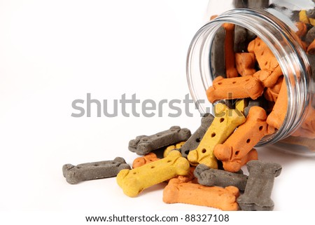 Dog biscuits spilling from a jar create a corner frame for your message.