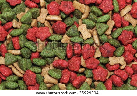 dog, cat, pets food design close-up on colorful pieces mixed flavoured food as delicious backdrop background for pet food advertisement  - stock photo